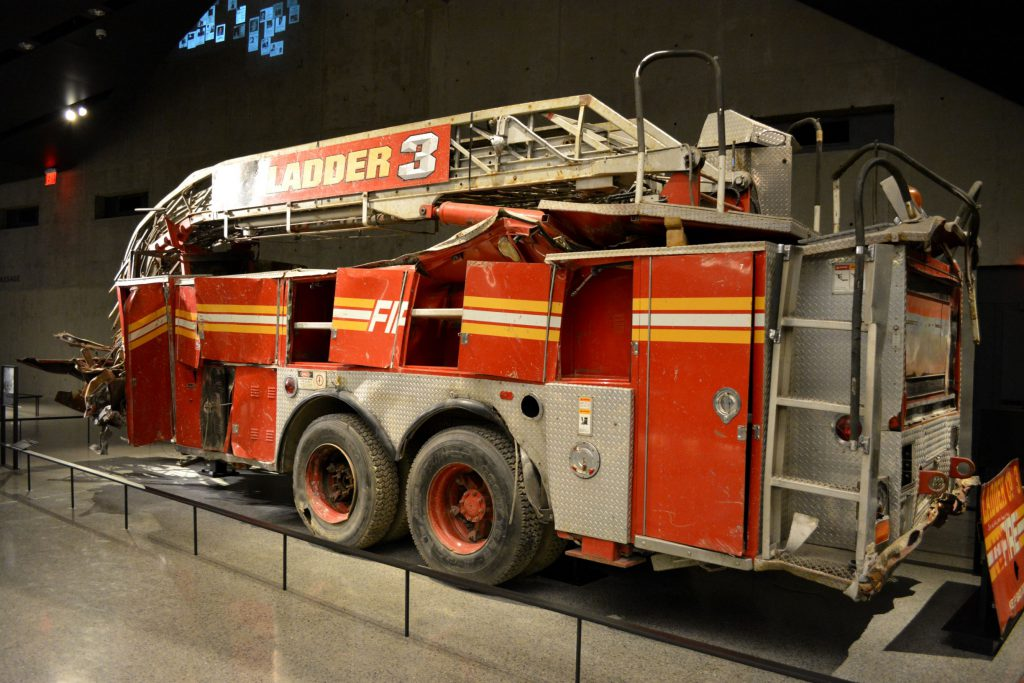 NEW YORK CITY, USA - May 17, 2014: Fire Engine destroyed in attacks on the Twin Towers at the National 9/11 Memorial Museum at Ground Zero in Lower Manhattan.