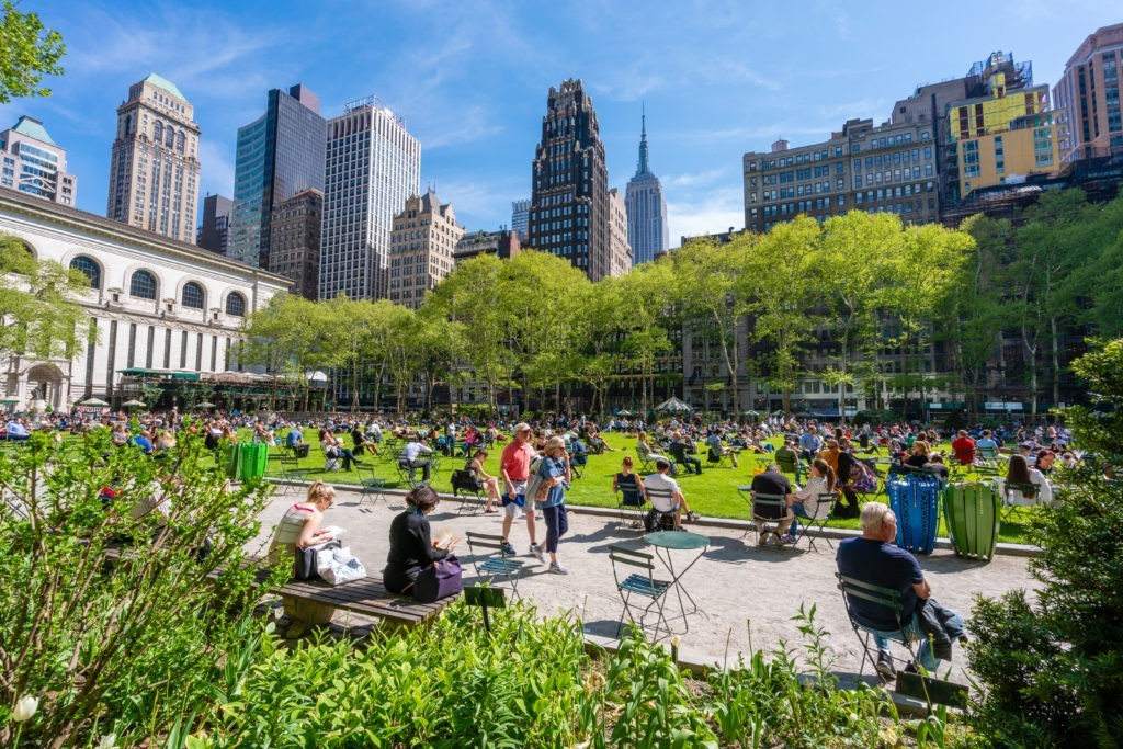New York, USA - May 10, 2018: People relaxing at Bryant Park in Midtown Manhattan