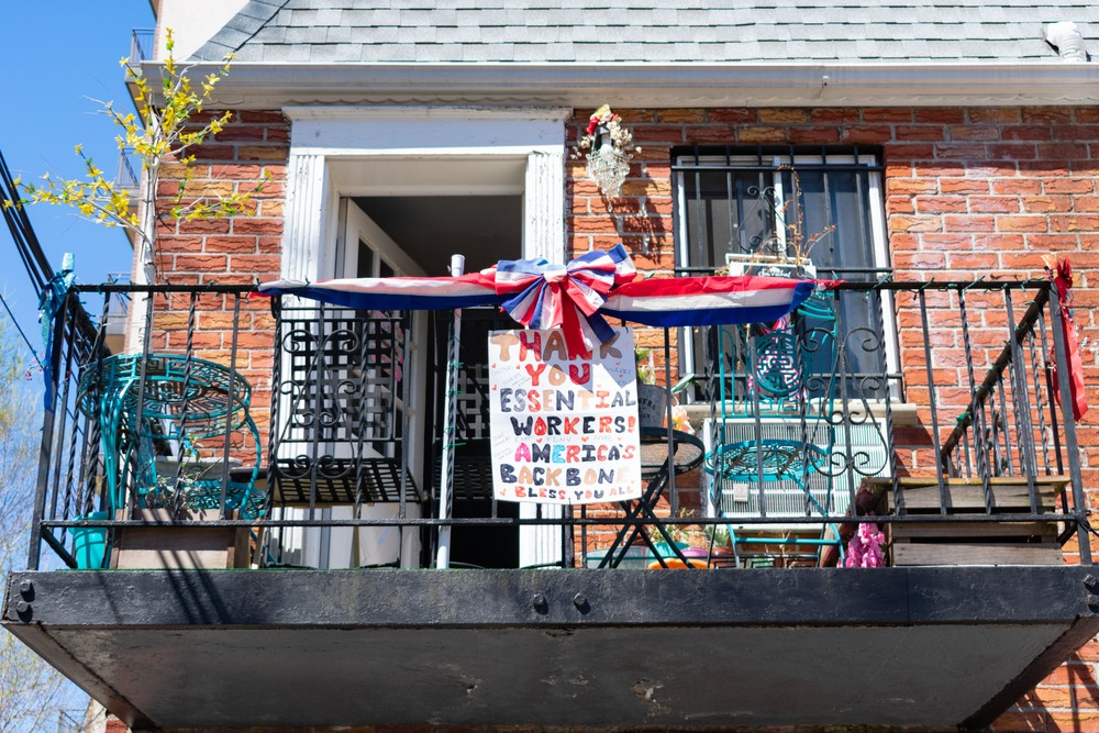 Astoria Queens, New York / USA - April 6 2020: Sign Thanking Essential Workers on a Home Balcony during the Covid 19 Outbreak in Astoria Queens New York