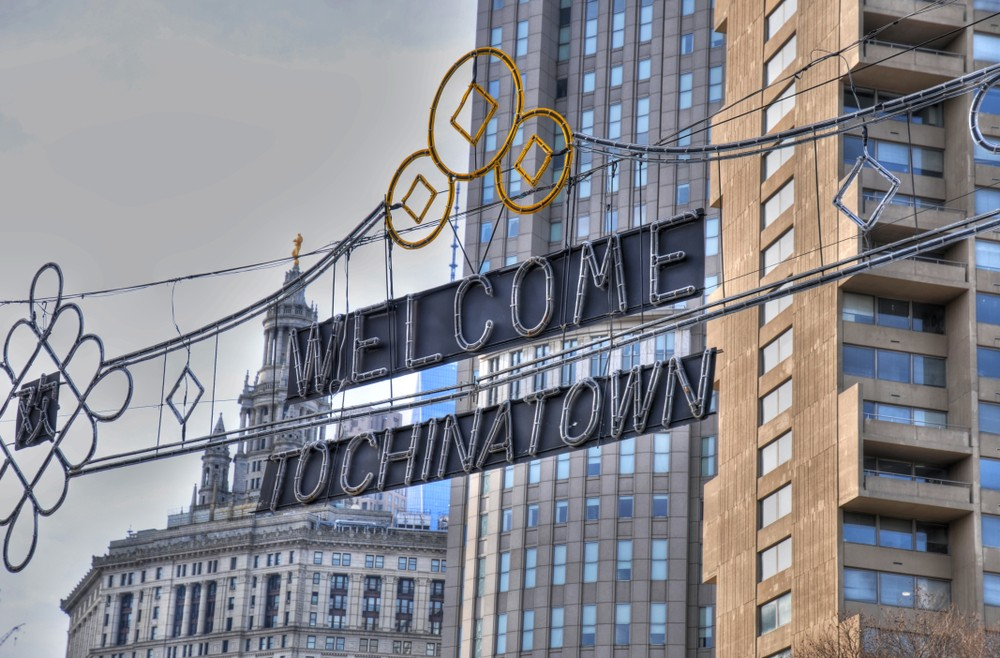 The famous ChinaTown Welcome sign at the entrance to China Town in Manhattan, New York City in the background of Manhattan Municipal Building