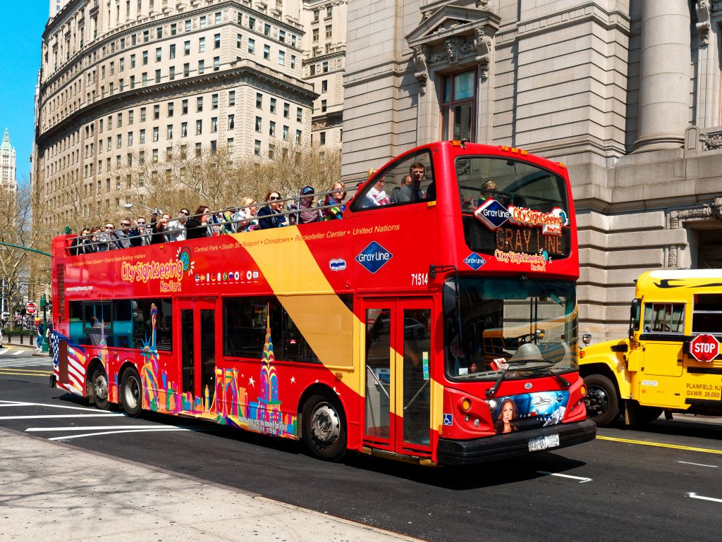 New York City, USA - April 2018: Double deck touristic sightseeing bus