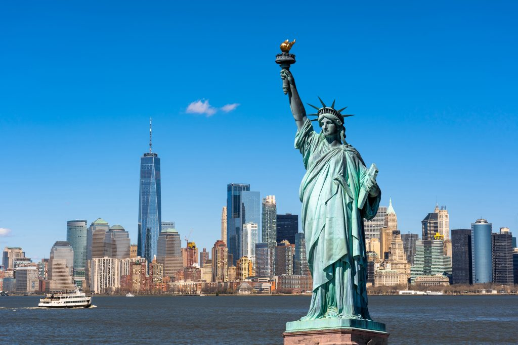 The Statue of Liberty over the Scene of New york cityscape river side which location is lower manhattan,Architecture and building with tourist concept